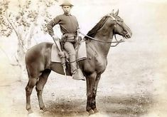 Young US Cavalry trooper posing on his horse, most likely post-Civil War. Notice his left hand draw revolver holster and Spencer rifle in the saddle scabbard.