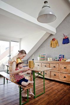 Justine Glanfield, a designer at Cotton and Milk, uses a traditional beer table in her son's arts and crafts area; photograph via Milk Magaz...