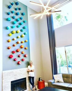 Modern Living Room Inspo - A large custom wall sculpture with a fresh, mid mod vibe. Created by Rosemary Pierce.