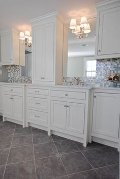 Marble counters glass tile back splash, lights on mirrors. Want 1st floor kitchen, similar to this... Gray floor, glass backsplash, white cabinets.