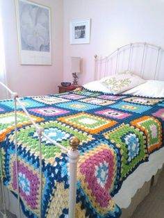 I taught myself to crochet granny squares to make an afghan for my guest bedroom. Inspired from colors and designs I found on Pinterest.