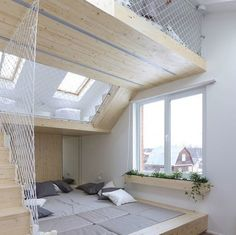To allow parents more time in bed, Russian architecture studio #RueTemple has added a play area above the master bedroom at this summer house to keep the children occupied. Very clever don't you think? #bedroominsperation #sharedbedroom #sleepinglate #playroom