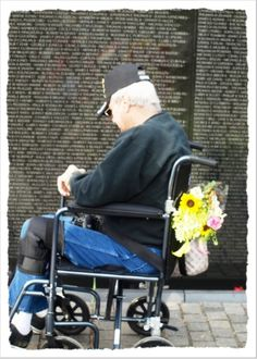 Wahington DC, Veteran's Day 2008, Giving homage to his fellow Fallen Brothers at the Vietnam Veteran's Memorial Wall by Karen Roie Forest