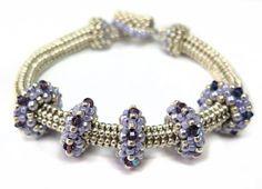 Seed bead jewelry Jewel School: Satellites Bracelet ~ Seed Bead Tutorials Discovred by : Linda Linebaugh Beaded Jewelry Designs, Seed Bead Jewelry, Jewelry Patterns, Handmade Jewelry, Beaded Bracelets Tutorial, Necklace Tutorial, Ring Tutorial, Beading Tutorials, Bead Weaving