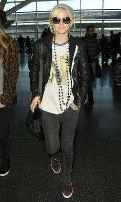 Leather jacket, Chanel necklace, graphic tee & sneakers.