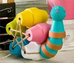 Clay Pot Snail with FolkArt Paint: 26 Budget-Friendly and Fun Garden Projects Made with Clay Pots Flower Pot Art, Clay Flower Pots, Flower Pot Crafts, Clay Pot Crafts, Diy Clay, Shell Crafts, Flower Pot People, Clay Pot People, Garden Crafts