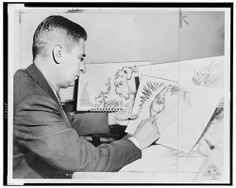 Taken in 1957, we found this photo fascinating only because it shows Dr. Seuss while working on a Grinch picture.