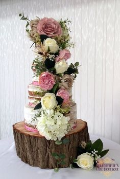 Semi naked wedding cake with silk flowers