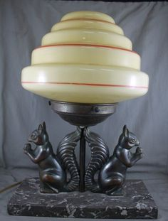 I love this! Art Deco Table Lamp, with a stepped cream shade, on support flanked by a pair of squirrels with nuts on grey marble base, h 32cm