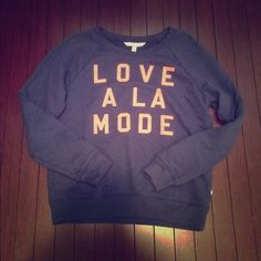 "Victoria's Secret Pullover Super cute VS pullover. Love A La Mode, means ""topped with ice cream, or Fashionable"" in French Only worn a hand full of times. Ask about creating a bundle to save, and check out my closet for free with purchase items! Victoria's Secret Sweaters"