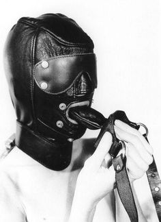 Female sucking cock with leather hood