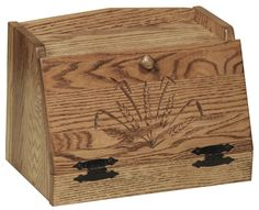 This Oak Top Bread Box with Wheat Carvings will give most any kitchen some extra storage along with some great looks.