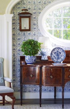 Interior Design : Anthony Baratta LLC   lovely blue and white wallpaper in this pretty, fresh traditional vignette with Hepplewhite or Sheraton sideboard and blue and white porcelains