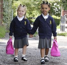 Let lessons begin: 'Million-to-one' black and white twins Marcia and Millie off to school for the very first time #DailyMail