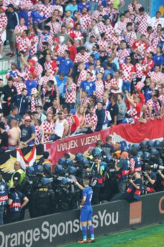 Ivan Perisic of Croatia gestures to supporters after flares were thrown onto the pitch during the UEFA EURO 2016 Group D match between Czech Republic...
