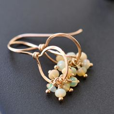 Opal earrings, Ethiopian Welo opals on rose gold filled handmade hoops... via Etsy