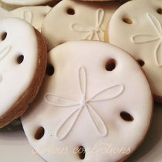 Sand dollar cookies  Royal icing decorated sugar cookies From Kathleen at curious confections in NJ Instagram: curious.confections