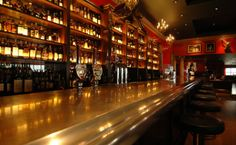 The Whisky Bar at Boisdale Canary Wharf: The bar, in the restaurant on the 2nd floor - a 12 metre long glowing amber wall of liquid gold - holds over 1,000 bottles of malt whisky and is undoubtedly be one of the most extensive and magnificent whisky bars in the world.