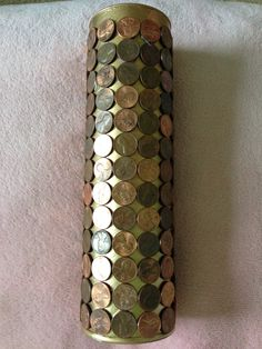 1. Spray paint a Pringles can 2. Hot glue pennies onto can 3. Gaze at your amazing handiwork!