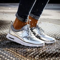 Nike Silver Thea Sneakers Sleek, lightweight sneaker from Nike with low-profile upper targeted for lightweight support. Max Air technology ensures maximum impact protection. Mesh at forefoot & perforations + sock liner adds breathability + comfort. Cont