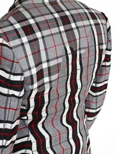Ichiro Suzuki - look carefully to see how masterfully the high back of the jacket uses what looks like the reverse side of the fabric sewn to the lower portion with a scalloped edge.  Notice how he used the red line in the plaid as the dominant line for matching the fabric so that the plaid pattern remains in tact.    I can only imagine how much clipping went into relaxing those curves.  Master Class.