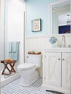 Pale blue walls and nautical details in this bathroom create a sea-inspred look: http://www.bhg.com/bathroom/decorating/cottage/bathroom-tour-cottage-style/?socsrc=bhgpin030215
