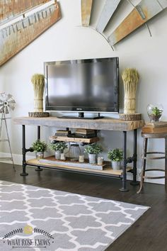 Do you know What Rose Knows? She knows how to make an incredible Industrial Farmhouse Reclaimed Wood & Black Pipe TV Stand or small console table…that;s what : ) Looking for a great weekend DIY Project…you just found it. Add some farmtastic style to your home with this table…it can be used for so many …