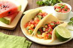 Why yes, watermelon can be eaten for dinner with these Spicy Shrimp Tacos made with sriracha and honey then topped with a cool Watermelon Salsa.