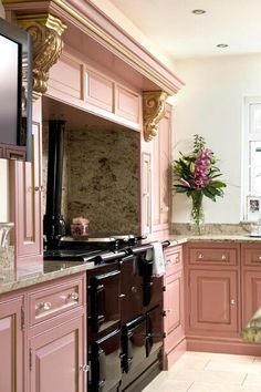 Dusty pink kitchen with black aga