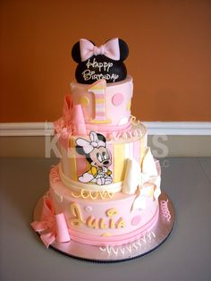 Minnie Mouse Birthday KAKE  Cakes iced in buttercream.  Marshmallow fondant decorations.  Ears are rice cereal.  Royal Icing Minnie :)