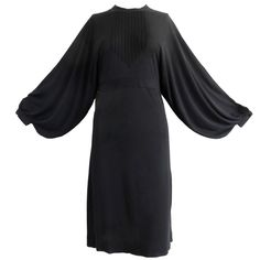 "1970's JEAN MUIR Pin-tucked LBD dress. ""matte-jersey; volume-shape sleeves-start at shoulder to open all way down to waist similar to kimono sleeve, taper to button-sleeve cuff; Pin-tucking features at chest area bib, skirt bottom and sleeves; concealed centre-back zipper; double self-covered  fabric buttons at back of neck and waistband."" $875. (Alan Hsu Vintage Modern). 