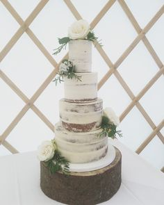 A clean white finished semi naked cake - dressed with fresh flowers and displayed on a wooden log stand. Fresh Flower Cake, Fresh Flowers, Dress Cake, Wedding Cakes, Naked, Design, Bridal Headpieces, Boyfriends, Wedding Gown Cakes