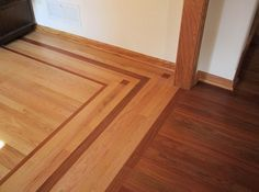 Different wood floors in house with border accent