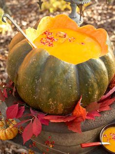 Butternut Squash Soup is served from a hollowed-out pumpkin tureen for a lovely autumnal touch.  Serve this warm, comforting meal for your next holiday party or outdoor picnic.