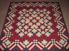 This quilt is Stars 'n' Stripes Forever, made from a 2001Judy Martin BOM from her web site.
