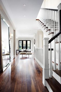 Oversized mirror, gorgeous wood floor…beautiful entry...natural light
