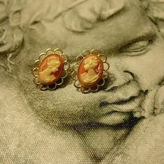 Cameo Earrings These are gold tone cameo earrings there is some tarnishing on the back price reflects that Jewelry Earrings