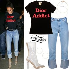 Kendall Jenner was spotted leaving the Lakers game at the Staples Center wearing a vintage Christian Dior 'Dior Addict' T-Shirt (Not available online), Re/Done The High Rise Straight Cuff Jeans ($72.00+), Frasier Stearling If You Had My Love Chokers ($31.00), a 7 Rings of Friendship Choker ($370.00) and Gold Hoop Earrings ($225.00) both by Erth and Ego Tasha Clear Calf Boots ($49.42).