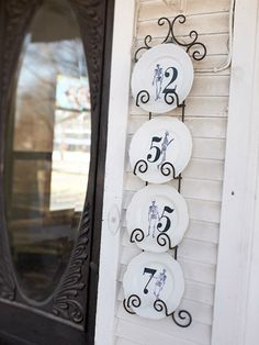 Now I really like this concept.  using Salvaged white plates and either decoupaged house numbers or painted on. This one was done for halloween and had the addition of skeletons on it. so cute.