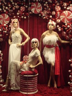 Peppermint Twist-  Holiday window display by Keith Dillion. We love that he always uses mannequins in his window displays in unique ways.    Mannequin Madness has the mannequins you need for your window display needs.