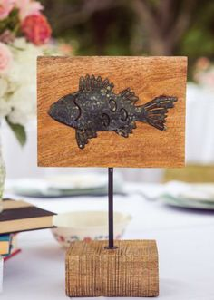 Wooden fish table signage. Photo by Randy Coleman Photography. #wedding #decor #fish #tablenumber