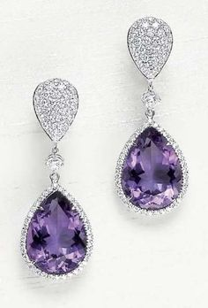 A Pair of Amethyst and Diamond Ear Pendants designed as a pavé-set diamond drop, suspending a circular-cut diamond collet, terminating in a pear-shaped amethyst, within a pavé-set diamond surround, mounted in white gold. Purple Jewelry, Amethyst Jewelry, Amethyst Earrings, Gemstone Jewelry, Diamond Earing, Diamond Jewelry, Wedding Rings Teardrop, Purple Stuff, Beautiful Earrings