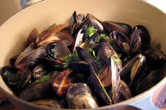 NYT Cooking: This straightforward method of cooking mussels or clams produces an excellent dinner in 30 minutes. You can build in extra flavors by varying the aromatic vegetables, the liquid and the last-minute stir-ins. All you need is some bread or simply cooked rice, grain or potatoes to sop up the broth.