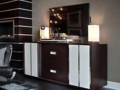 Fashioned from maple wood and veneers, a two-drawer dresser with sliding panels serves as storage unit, console table and bar.  #HGTVUrbanOasis  http://www.hgtv.com/urban-oasis/hgtv-urban-oasis-2013-living-room-pictures/pictures/page-11.html?soc=pinterest