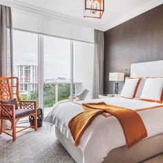 """""""The owner loves chocolate brown. Well, I love orange. And the owner said, 'No, no, no.' I said, 'Trust me.' She did, and it's fabulous!"""" - Interior Designer Laura Martzell on the unexpected color combination in a Miami master bedroom #LuxeMiami Nov/Dec Interiors: Laura Martzell Designs Photo: Emilio Collavino @sandow • • • #instaluxe #luxuryinteriors #masterbed #orange #chocolatebrown #colorcombo"""