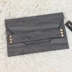 Black & Grey Wood Grain Envelope Clutch Super cute!!! Grey and Black wood grain design clutch with gold tone studs and removable strap. Bags Clutches & Wristlets
