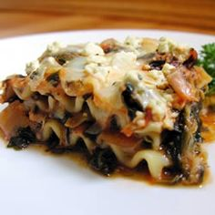 "Artichoke Spinach Lasagna | ""When a 10 yr old wakes up and aks for this again, I know it's a hit! Definitely a keeper...will make again!"" http://allrecipes.com/recipe/artichoke-spinach-lasagna/Detail.aspx"