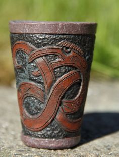 Viking ceramic shot glass with carved dragon pattern. Kvalka's Art and Craft on Etsy.