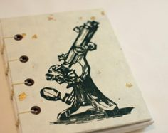 Blank journal, log, or notebook with a screenprinted microscope on white paper flecked with gold, coptic bound, recycled, science - no. 1050