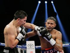 Leo Santa Cruz, left, and Cesar Seda, right, trade hits during their WBC super bantamweight title fight on Saturday, Dec. 14, 2013, in San Antonio. (AP Photo/Eric Gay)